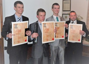 The first batch of new Dan Grades receive their black belts and certificates on Wednesday 12th December 2012